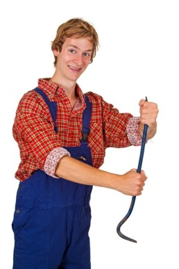 1542931-young-man-in-overalls-holding-a-crowbar-isolated